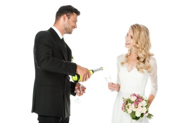 Groom pouring champagne while bride holding glass isolated on white stock vector