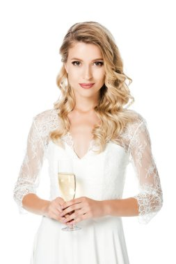 happy young bride with glass of champagne looking at camera isolated on white