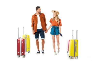 Newlywed couple holding hands and looking at each other with suitcases around isolated on white stock vector