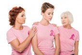 women in pink t-shirts supporting upset woman isolated on white, breast cancer concept