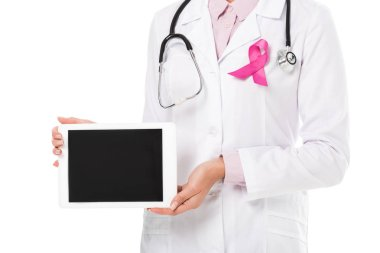 cropped shot of doctor with pink ribbon holding digital tablet with blank screen isolated on white, breast cancer awareness concept