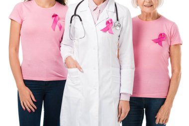 cropped shot of doctor and women with breast cancer awareness ribbons isolated on white