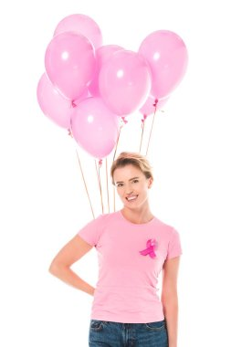 Middle aged woman holding pink balloons and smiling at camera isolated on white, breast cancer concept stock vector