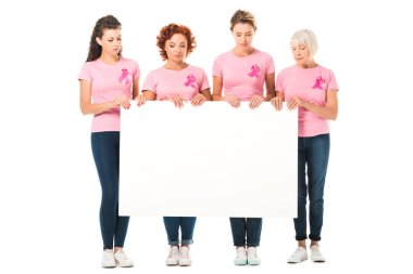 women in pink t-shirts with breast cancer awareness ribbons holding blank banner isolated on white