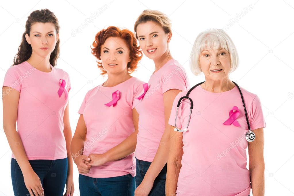 Women in pink t-shirts with breast cancer awareness ribbons and senior doctor with stethoscope smiling at camera isolated on white stock vector