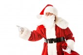Santa claus mutat oldalon, miközben keresi a kamera elszigetelt fehér