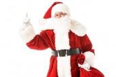 Santa claus mutat, miközben nézi a kamera elszigetelt fehér