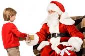 Fotografie Santa Weihnachtsgeschenk präsentieren, isoliert auf weiss kid