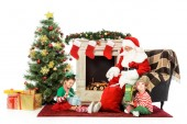 kids and santa sitting in front of fireplace together isolated on white