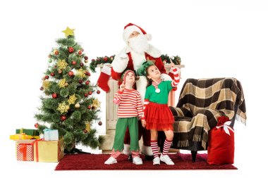 Kids and santa standing near fireplace and christmas tree and looking up isolated on white stock vector