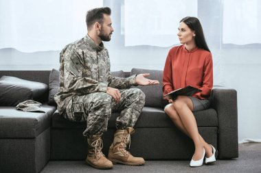 Soldier in military uniform with ptsd talking to psychiatrist at therapy session stock vector