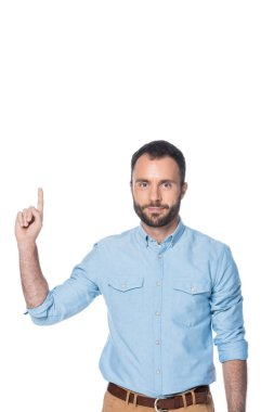 man in blue shirt pointing up isolated on white