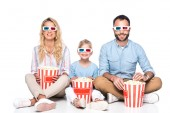 Fotografie happy family with popcorn isolated on white
