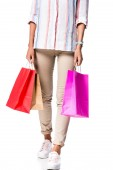 Fotografie cropped view of woman holding shopping bags isolated on white