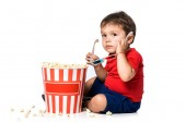 Fotografie boy with popcorn and 3d glasses isolated on white