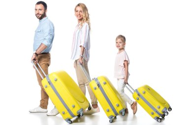 side view of family with yellow travel bags isolated on white