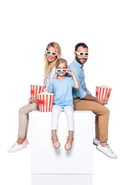 Family with popcorn sitting on white cube isolated on white stock vector