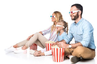 family with popcorn watching movie isolated on white