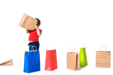 child playing with shopping bags isolated on white .