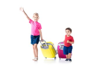brother and sister with suitcases isolated on white