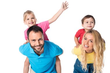 happy parents piggybacking kids isolated on white