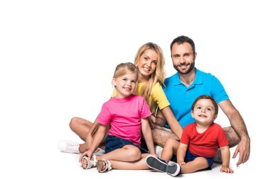 happy family sitting isolated on white