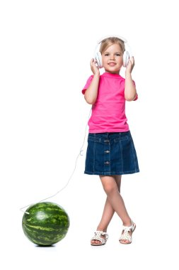 child listening music on headphones isolated on white, technology concept