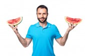 man with two slices of watermelon isolated on white