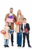 Fotografie stylish parents and adorable kids holding presents, isolated on white