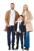 parents in beige coats hugging son in autumn outfit, isolated on white