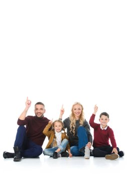 happy family with kids pointing up, isolated on white