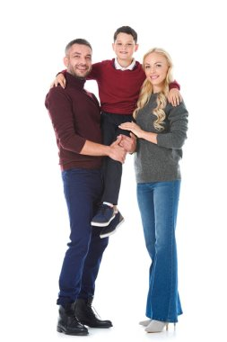happy parents holding son on hands, isolated on white