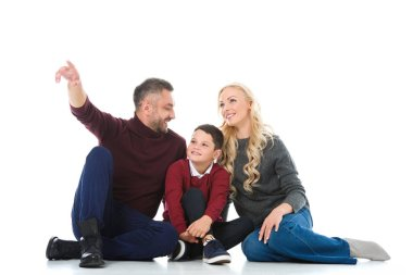 parents and son in autumn outfit, man showing something isolated on white