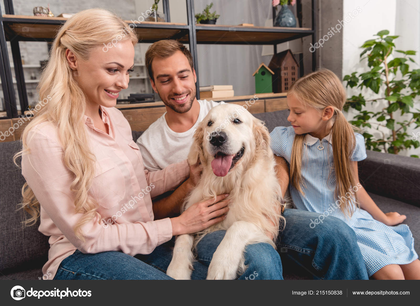 Parents Daughter Playing Dog While Sitting Couch Home Stock Photo