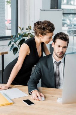 young seductive businesswoman flirting with colleague during work in office