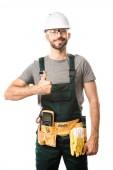 usměvavý pohledný elektrikář ukazuje palcem nahoru izolované na bílém