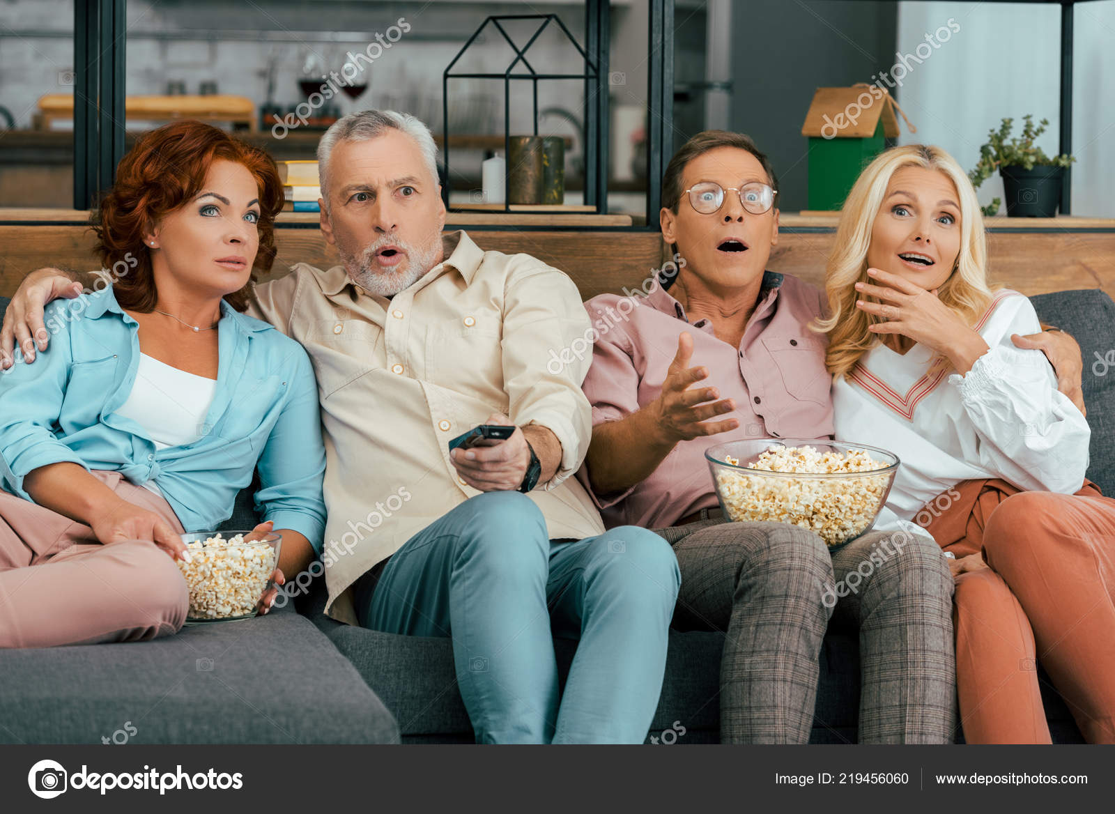 Shocked Senior Man Watching Tv With Remote Control Stock