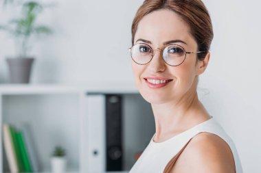 Portrait  of attractive smiling businesswoman in eyeglasses stock vector