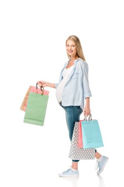 Happy pregnant woman with shopping bags isolated on white stock vector