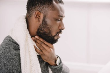 diseased african american man having sore throat