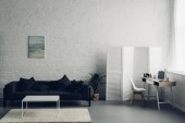 Photo interior of living room with couch and workplace with laptop