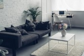 Photo interior of modern living room with couch and workplace with laptop