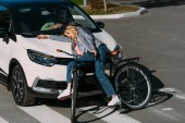Fotografie young woman got mowed down by car while driving bicycle on road, car accident concept