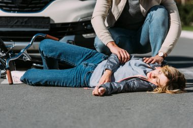 young woman mowed down by driver in car on road, car accident concept
