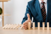 Fotografie close up of businessman with blocks wood game in office, insurance concept