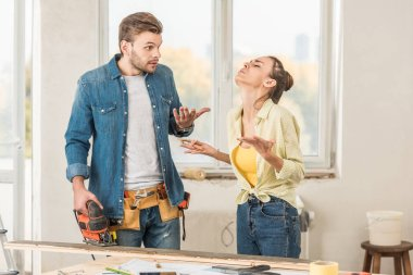 emotional young couple quarreling during home improvement