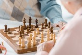 close up of senior couple playing chess together