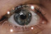 Fotografie cropped shot of female eye looking at camera, cyber security concept