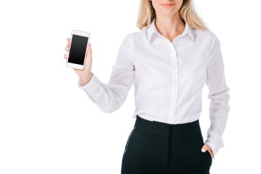 cropped shot of businesswoman showing smartphone with blank screen isolated on white