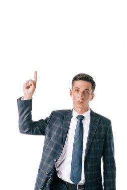 portrait of businessman in suit pointing up isolated on white
